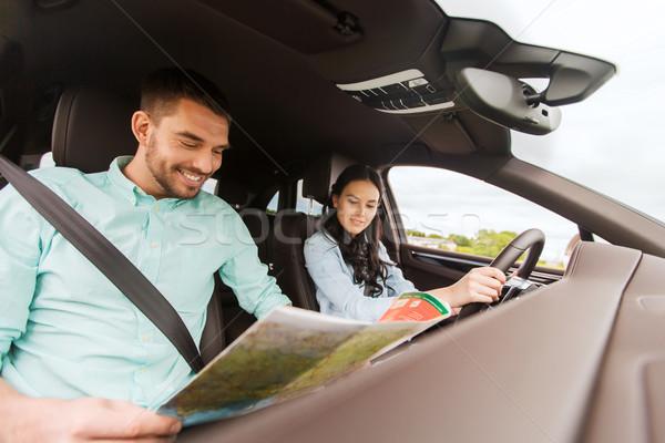Boldog férfi nő autótérkép vezetés autó Stock fotó © dolgachov