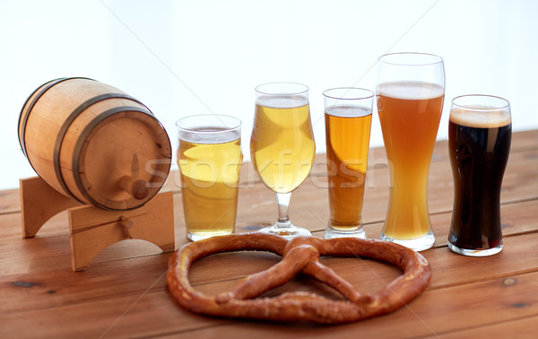 close up of beer glasses, barrel and pretzel Stock photo © dolgachov