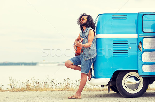 hippie man playing guitar over minivan on beach Stock photo © dolgachov