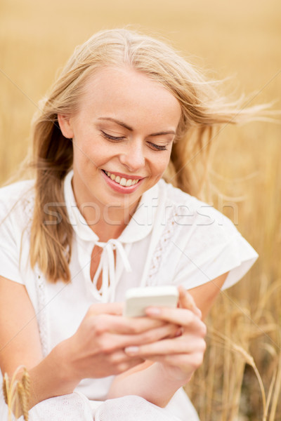 Felice smartphone cereali campo estate Foto d'archivio © dolgachov