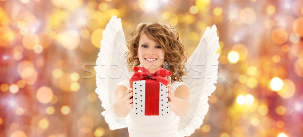 Boldog nő angyalszárnyak karácsony ajándék emberek Stock fotó © dolgachov