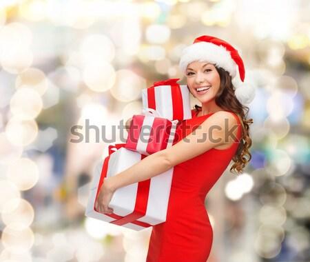 beautiful sexy woman in santa hat with gift box Stock photo © dolgachov