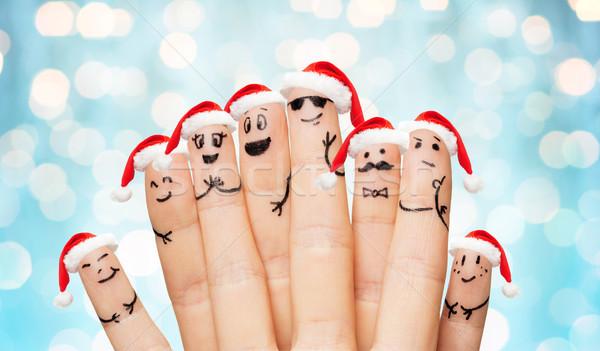 Mani dita facce famiglia Foto d'archivio © dolgachov