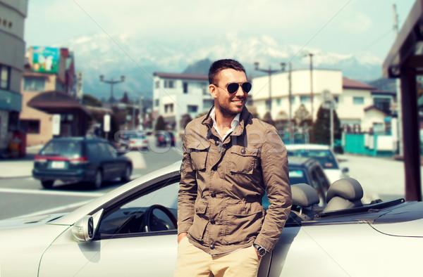 Szczęśliwy człowiek kabriolet samochodu miasta Japonia Zdjęcia stock © dolgachov