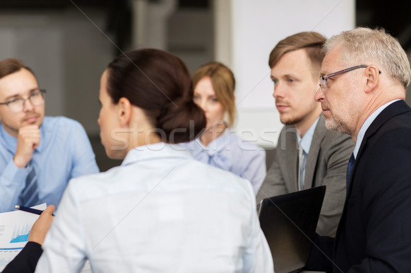 smiling business people meeting in office Stock photo © dolgachov