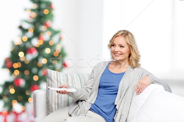 笑顔の女性 制御 クリスマス テレビ 休日 ストックフォト © dolgachov