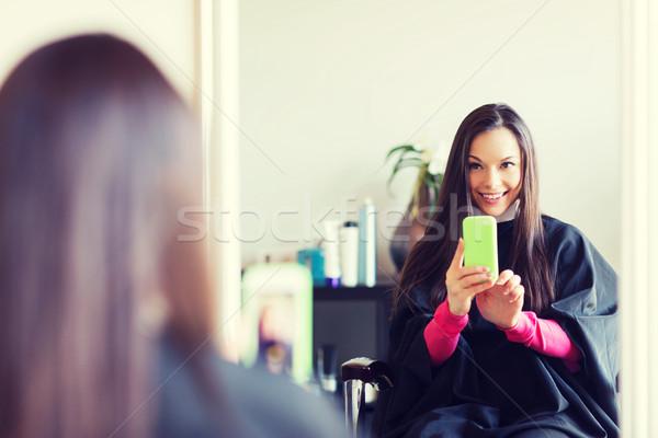 幸せ 若い女性 美容院 美 人 スマートフォン ストックフォト © dolgachov