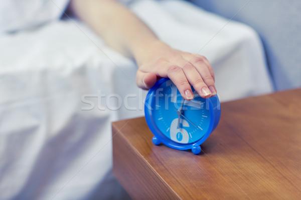 Mano sveglia camera da letto mattina risveglio Foto d'archivio © dolgachov