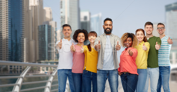 group of people showing thumbs up  in dubai Stock photo © dolgachov