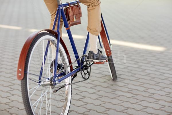 close up of hipster man riding fixed gear bike Stock photo © dolgachov