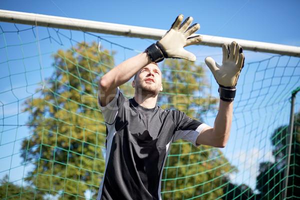 goalkeeper or soccer player at football goal Stock photo © dolgachov