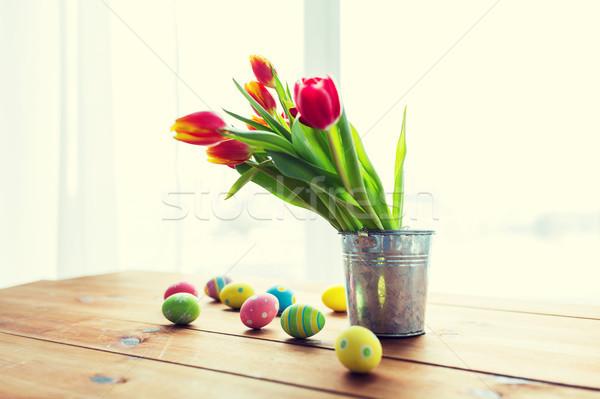 Paaseieren bloemen emmer Pasen vakantie Stockfoto © dolgachov
