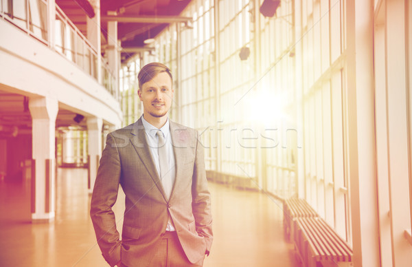 young businessman in suit at office building hall Stock photo © dolgachov
