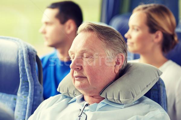 senior man sleeping in travel bus with neck pillow Stock photo © dolgachov