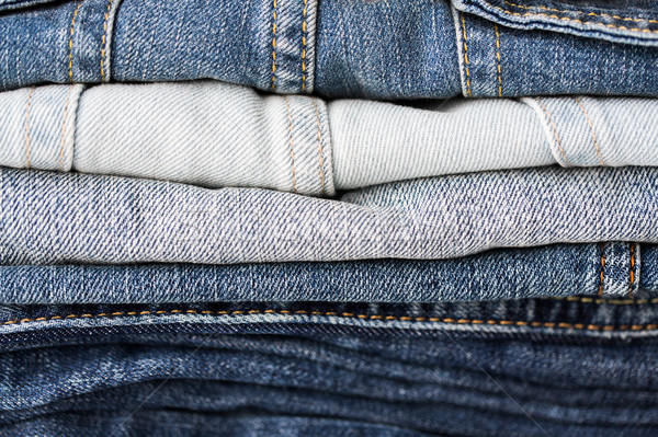 close up of denim clothes or jeans pile Stock photo © dolgachov