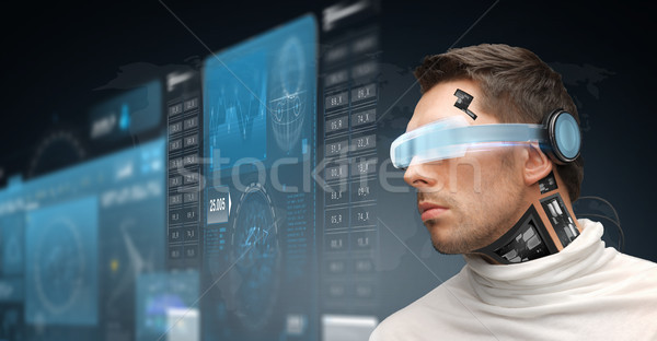 man in virtual reality glasses and microchip Stock photo © dolgachov