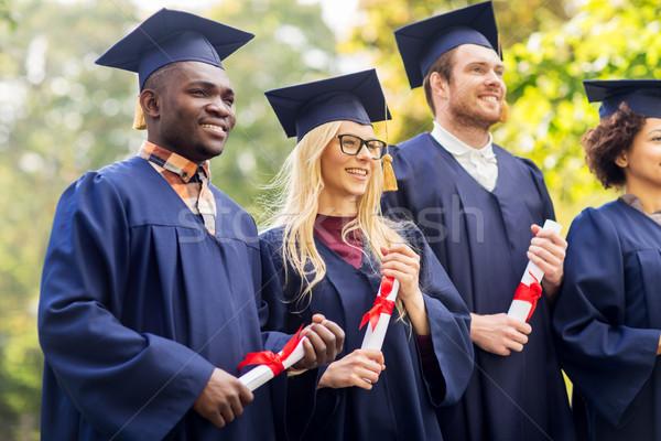 Szczęśliwy studentów edukacji ukończeniu ludzi grupy Zdjęcia stock © dolgachov