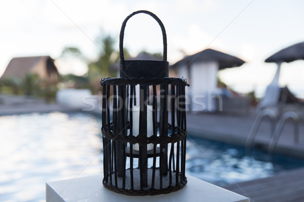 lantern with candle at outdoor swimming pool Stock photo © dolgachov
