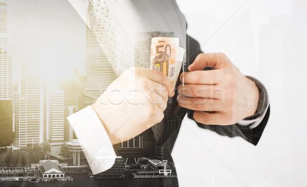 ビジネスマン ユーロ お金 ビジネス ストックフォト © dolgachov