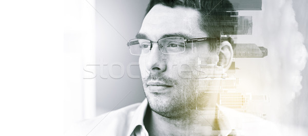 Stock photo: portrait of businessman in eyeglasses at office