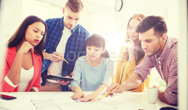 creative team with blueprint working at office Stock photo © dolgachov