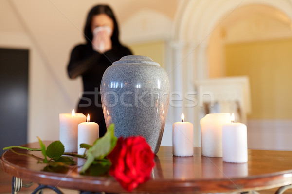cremation urn and woman crying in church Stock photo © dolgachov
