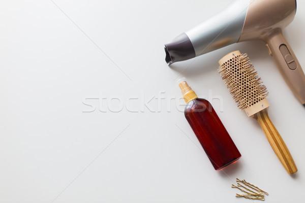hairdryer, brush, hot styling hair spray and pins Stock photo © dolgachov