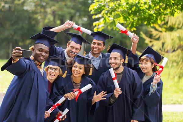 Estudiantes graduados toma educación graduación tecnología Foto stock © dolgachov