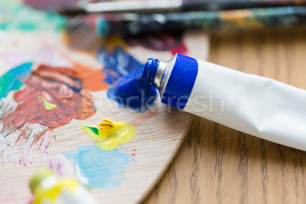 acrylic color or paint tubes and palette Stock photo © dolgachov