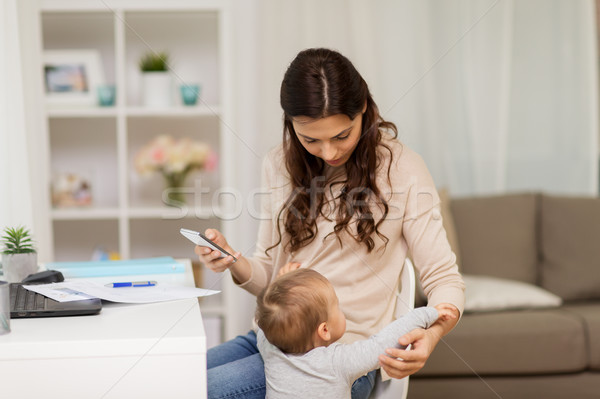 baby boy disturbing mother working at home Stock photo © dolgachov