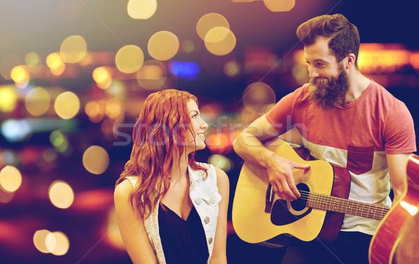 Paar muzikanten spelen gitaar lichten muziek Stockfoto © dolgachov