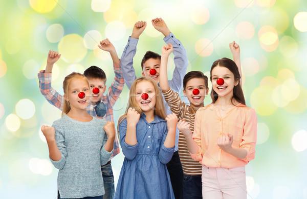 Feliz crianças vermelho nariz dia caridade Foto stock © dolgachov