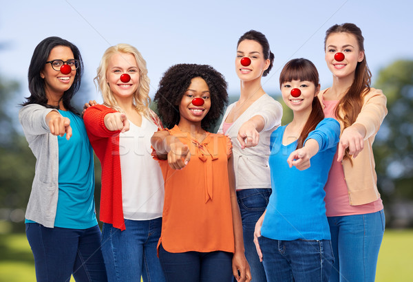 group of women pointing finger at red nose day Stock photo © dolgachov