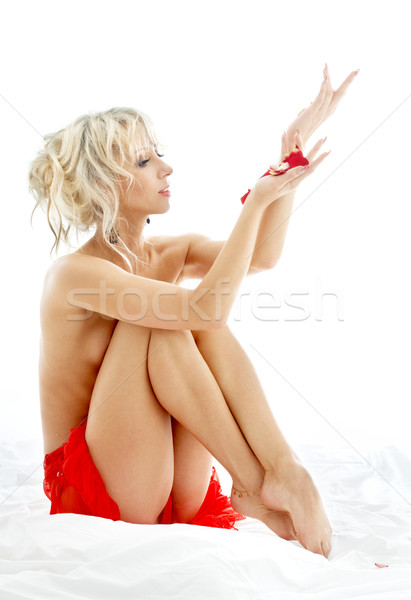 topless blond with rose petals in spa Stock photo © dolgachov