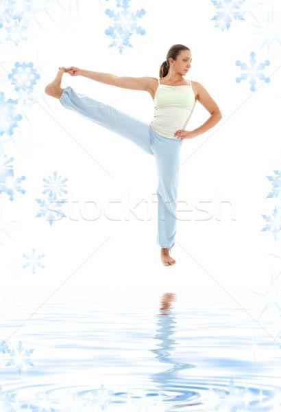 yoga standing on white sand Stock photo © dolgachov