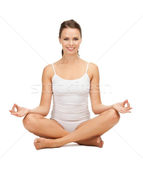 Kadın pamuk yoga lotus poz Stok fotoğraf © dolgachov