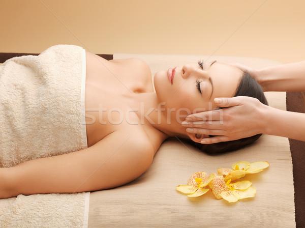 Stock photo: woman in spa salon lying on the massage desk