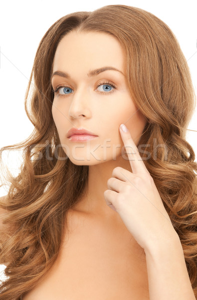 woman pointing at her cheek Stock photo © dolgachov