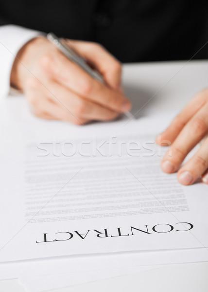 man with contract Stock photo © dolgachov
