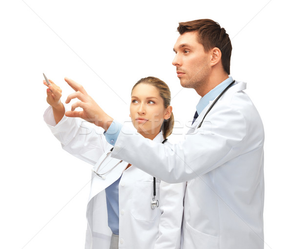young doctors working with something imaginary Stock photo © dolgachov