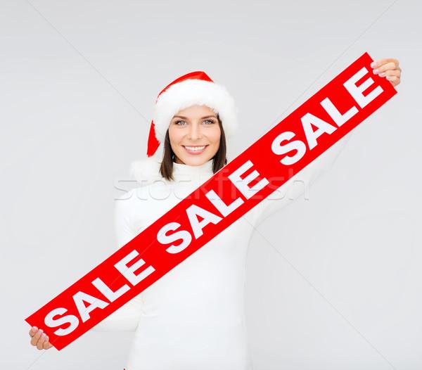 Mulher ajudante seis vermelho venda Foto stock © dolgachov