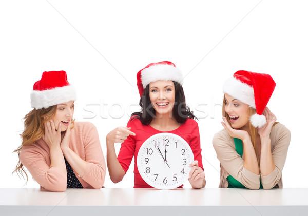 Nők mikulás segítő sapkák óra mutat Stock fotó © dolgachov