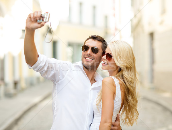 travelling couple taking photo picture with camera Stock photo © dolgachov