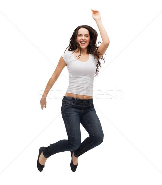teenage girl in white blank t-shirt jumping Stock photo © dolgachov
