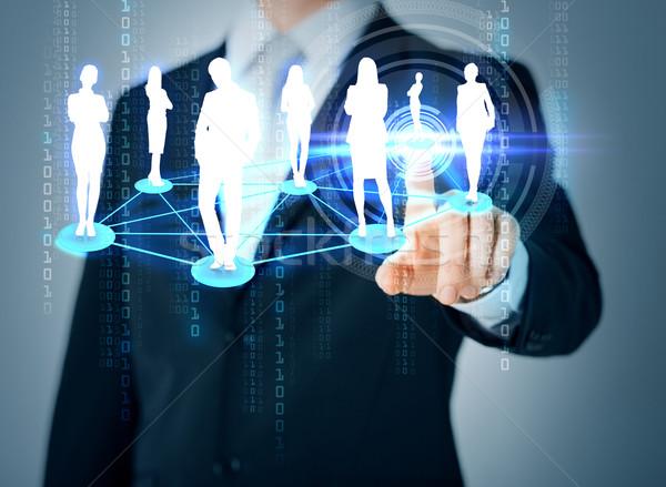 Człowiek strony wskazując społecznej business network działalności Zdjęcia stock © dolgachov
