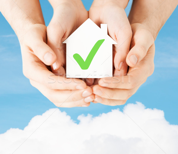 hands holding house with check mark Stock photo © dolgachov