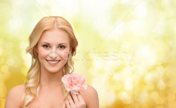 smiling woman with peony flower Stock photo © dolgachov