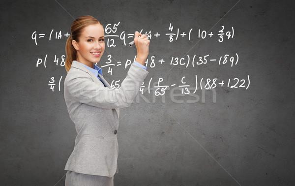 Zakenvrouw schrijven formule fiche kantoor business Stockfoto © dolgachov