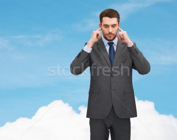 Geërgerd zakenman oren handen business man Stockfoto © dolgachov