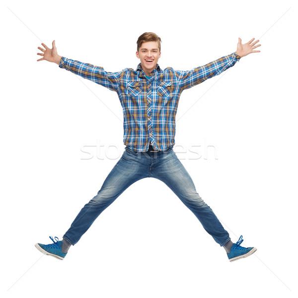 Sonriendo joven saltar aire felicidad libertad Foto stock © dolgachov
